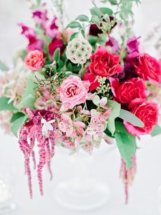 berry hued floral arrangement, photo by Amy Arrington http://ruffledblog.com/georgia-wedding-with-the-ultimate-naked-cake #weddingflowers #centerpieces