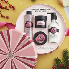 Give the gift of elegance this holiday with the British Rose Deluxe Gift Set. This regal set includes our best-selling British Rose products infused with with pure rose essence for a light floral scent to gently hydrate and cleanse skin. The perfect gift fot the royalty in your life. A $75 Value!   Set Includes British Rose Fresh Plumpinf Facial Mask 3 oz British Rose Instant Glow Body Essence 8.45 oz British Rose Instant Glow Body Butter 1.7 oz Petal Soft British Rose Bath Foam 8.45 oz