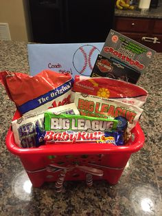 Made this gift basket for TJs tee ball coach. Filled with sunflower seeds, big league chewing gum, cracker jacks, and lotto tickets.