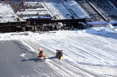 Workers armed with shovels attacked the stadium seats while others were assigned the arduous task of pushing snow across the field in preparation for Super Bowl XLVIII.