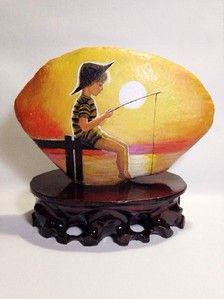手绘石头 夕阳下的垂钓男孩