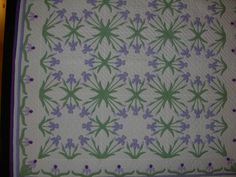 Iris made by Martha Harvey, 1994 Marie's fascinating Iris design was published in the Ladies' Home Journal on January 1, 1911.  The leaves made an unusual secondary pattern as they meet at the edges of the blocks.  collection of Martha Harvey.  I am in the process of making this quilt.