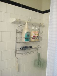 hang shower caddy on towel bar using closet hooks.