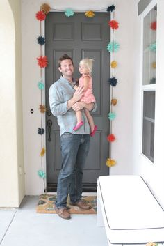 DIY Flower garland to hang around the door. Would be cute with tissue paper flowers, too