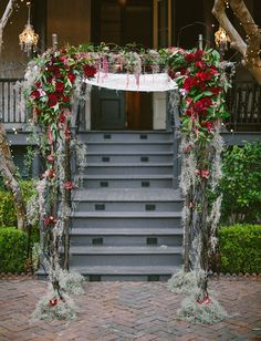Red rose and spanish moss arbor