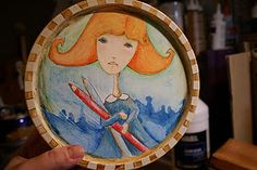 http://clbcreations.blogspot.com/2012/01/free-tutorial-upcycled-cookie-tin-using.html