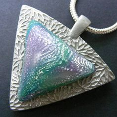 """""""Lilac Seas"""" From Pips Jewellery Creations on Flickr. Mokume Gane Technique. Silver Leaf, tinted translucent polymer clay. No varnish, no glaze, just handsanded and polished."""