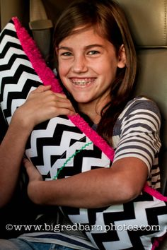 "Seatbelt pillow - made from 100% cotton, soft fuzzy fleece or minky, velcro and poly fill pillow stuffing. It measures 28"" x 8"" and includes two seat belt straps and a 5.5"" front pocket for easy iPod storage."