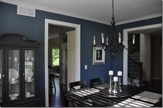 Love this blue color in the dining room.  This has a house tour and tells you each color they used.  Great for paint ideas.