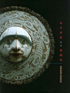Book cover featuring a mask by Duane Pasco