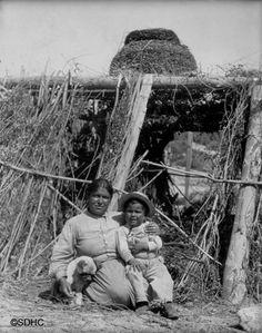 Carolina Leto and son under granary basket, San Ignacio Village, April Los Coyotes Reservation, Cahuilla and Cupeno Indians. Native American History, Native American Indians, American Life, Native Americans, Indian Village, California, Coyotes, Old West, San Diego