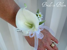 This elegant calla wrist corsage with ivory or white pearl bracelet is a wonderful accessory for weddings or proms.