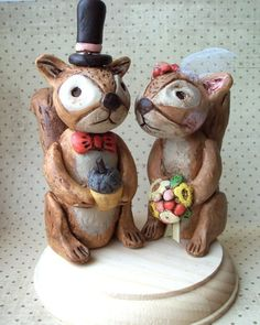 cake topper. tails need to be more bushy. maybe just the bow tie on the guy and the girl holds the acorn.
