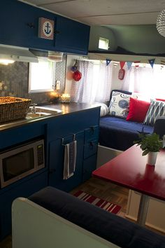I have two photos of this rv pinned. I love the blue cabinets and pops of red (the other pic pinned shows the awesome lighting idea, in red).