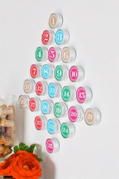 These buttons could be nice for a homemade calendar on the wall. It would be easy since they have numbered stickers at dollar tree and little favor tins. I would need 31obviously.