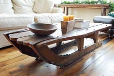 An old sled turned into a table, how cool is that!!