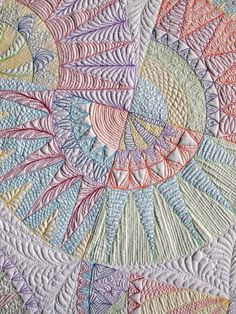 Wholecloth #quilt featuring a large selection of dense filler patterns in different colour threads by Emma (Sampaguita Quilts).