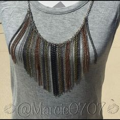 💜Sale💜Ladies sleeveless top Ladies grey sleeveless top with silver, gold, and black accent chain necklace attached. Made by Cha Cha Vente Cha Cha Vente Tops Tank Tops