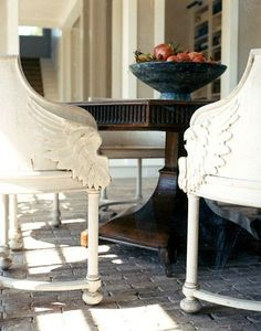 If only i can find these chairs! close up of wing detail on the white wood chair arms