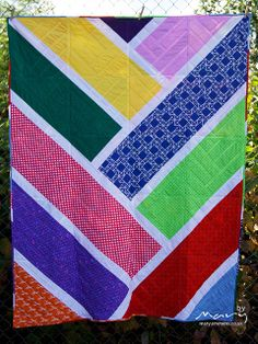 Broken Herringbone Quilt - (back by tobit_e, via Flickr) - with a large herringbone back - awesome!