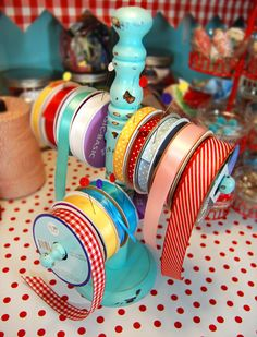 I like this idea for placing on your work space and having the ribbons that you need for your current project available and at hand. When you are done, just put them back and then gather more ribbon for your next project.