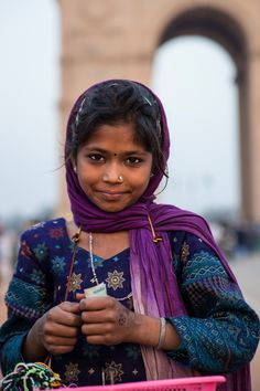 https://flic.kr/p/ru2aqx | Bracelet Girl | India Gate is the structure in the background.  This girl, maybe 9 or 10 years old, made bracelets for rupees.  Our traveling companion had a couple of bracelets made. I gave the kid some more money to take her picture.    New Delhi, India.