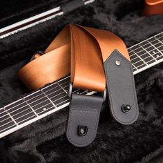 Rubington guitar straps with built-in strap locks and 3-ply Italian leather badges! Handcrafted in USA.