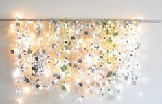 Use a curtain rod, mirror garland and white lights to create this starry sky