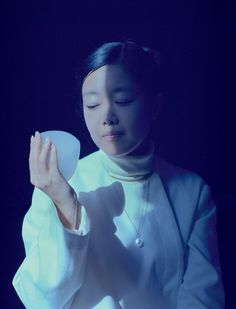 Mariko Mori:  The installations, videos, sculptures and photographs she has been making over the past 18 years could have been dropped from another dimension. Hers is a world of digitally inner-lit pods and films of floating gods, that has been a large influence on the digital aesthetic of a younger generation