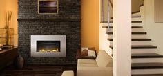 The Napoleon Plazmafire™ Vent Free propane gas fireplace features easy installation plus all of the conveniences of a gas fireplace. Direct Vent Gas Fireplace, Vented Gas Fireplace, Propane Fireplace, Modern Fireplace, Fireplace Stores, Brick Paneling, Hanging Pictures, Napoleon, Picture Wall