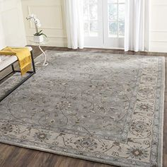 Safavieh Heritage Collection HG862A Handcrafted Traditional Oriental Beige and Grey Wool Area Rug (8' x 10') $350