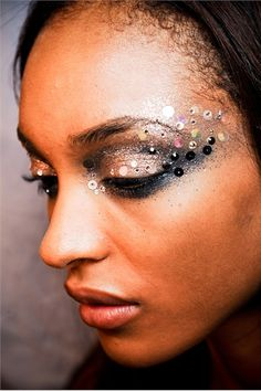 Sequin Studded Eyes - this could have been amazing.... feather lashes and a sharper brow