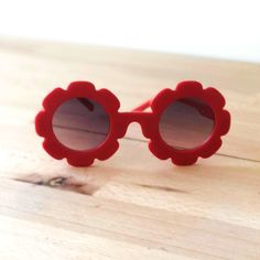 The perfect little pair of sunglasses for everyday use. Girls sunglasses, suitable for ages 6 years. Little flower style, red colour frames, round black gradient lens Soft and comfortable fit. Flower Sunglasses, Girl With Sunglasses, Red Sunglasses, Flower Fashion, Flower Shape, Bel Air, Baby Accessories, Wildfox, Shoe Collection