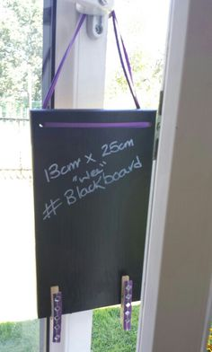 Recycled kitchen drawer front into chalkboard with pegs for attaching messages!