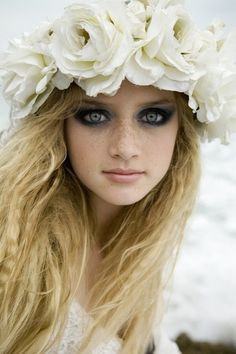 Dark smokey eyes add contrast to a sweet and innocent face.