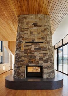 Feature fireplaces double sided Cheminees Philippe. Stone Stack - Holiday House by b-k-k.com.au. Photo: Peter Bennetts