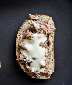 http://www.howsweeteats.com/2012/12/crockpot-pulled-pork-beer-cheese-grilled-cheese-sandwiches/#