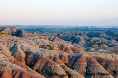 The Badlands in South Dakota. Try to time it so you drive through about 45 min before dusk/sundown. You won't regret it!