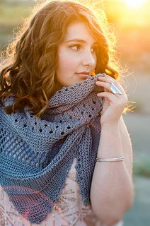 The asymmetric lines and shifting patterns of this lightweight shawl will carry you away on an ocean breeze. Reminiscent of the sweeping landscape of beachy Dunes and the rippling of the waves as they rush onto the sand. This oversized shawl is the perfect accessory for a chilly summer night but light enough for a warm, balmy day as you journey over the Sea.