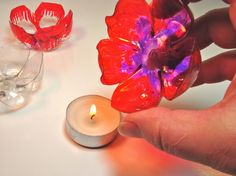 This is quite cool and super cheap. Easy to change decor and a great way to have tea lights everywhere and adding colour