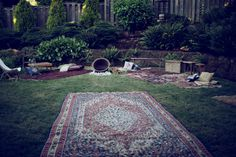 love the idea of throwing big rugs on the ground for an outdoor party for extra seating....