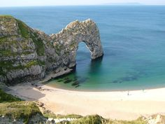One of England's most famous landmarks, Durdle Door is a perfect rock arch at one end of a beautiful fine shingle crescent of beach.