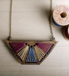 Embroidered Wood Pendant Necklace, Magenta & Blue | Inspired by the rising sun, this geometric wood necklace is fi... | Necklaces