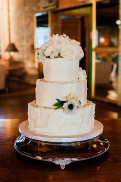 Three tier rustic buttercream wedding cake topped with gorgeous fresh floral. Metallic Wedding Cakes, Ivory Wedding Cake, Painted Wedding Cake, Wedding Cake Photos, Wedding Cake Designs, Buttercream Wedding Cake, Warehouse Wedding, Unique Cakes, Wedding Cake Inspiration