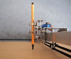 CNC Pen Lift: a. text-decoration: none; } This instructable describes a low-cost CNC pen-lift that: accepts diffe. Make 3d Printer, 3d Printer Models, Arduino Cnc, Diy Cnc Router, Diy Electronics, Electronics Projects, Homemade Cnc, Drawing Machine, Router Projects
