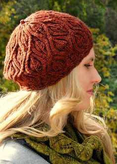 This cabled leafy beret knit up in rich autumnal tones makes for a perfect fall accessory. The beautiful all-over stitch pattern is striking and fun to knit.