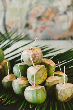 Tropical coconut drinks with straws to keep your guests cool!