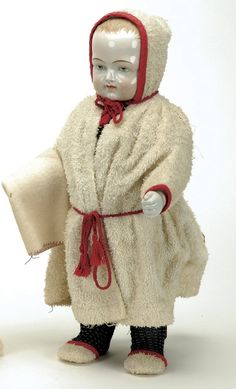 "Germany, ca. 1880, one piece nicely tinted china body with blonde molded and brush stroked hair, blue painted eyes, nicely sculpted torso with clenched fists, wearing a terry bathrobe trimmed in red while holding a bath towel. Size: 16"" t."