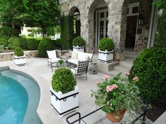 Poolside seating group on a limestone terrace.  Custom designed box planters.