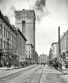Looking west along Madison Avenue old trolley rails ( tall structuer at rear left now Madison Hotel and U of M Law School is at the road's end ) toward the Mississippi River and western USA beyond. There's a newer trolley line located on this street today. ( see my Madison Ave board )   Memphis, Tennessee c. 1906